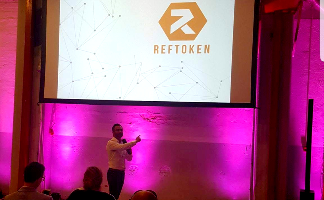 Jan CEO RefToken speaking at blockchain conference